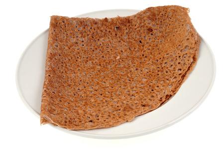 Black wheat pancake on a plate