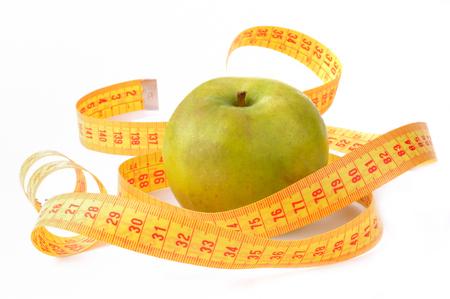 Apple and flexible meter Stock Photo