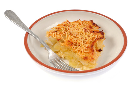 Part of gratin Dauphinois on a plate