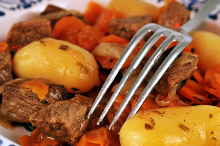 Plate of beef with carrots and potatoes