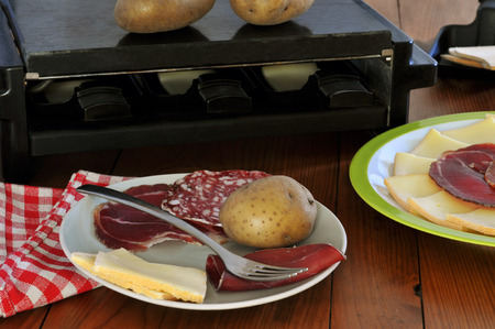 Apparatus and ingredients for a raclette