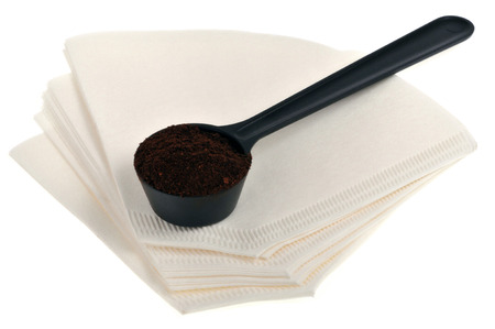 Coffee filters and measuring spoon Stock Photo