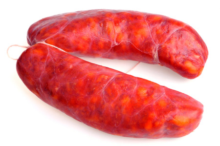 Chorizos to cook on a white background