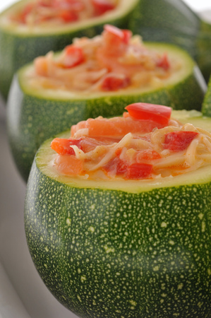 Round zucchini stuffed with vegetables