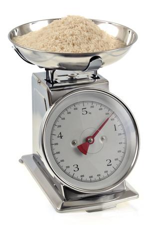 Weigh rice Standard-Bild