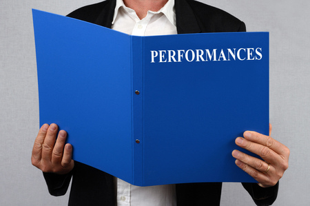Performance record in hand Stock Photo