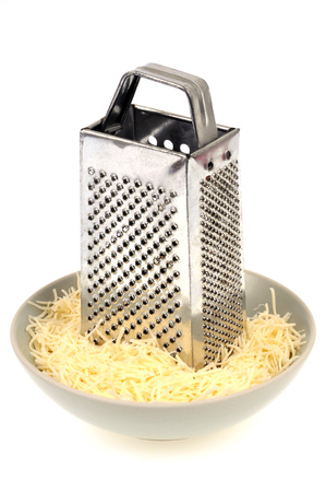 Cheese grater and grated cheese
