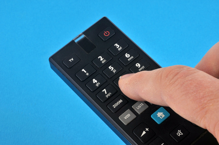 Remote control on a blue background