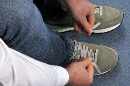 To tie his shoelaces Stok Fotoğraf