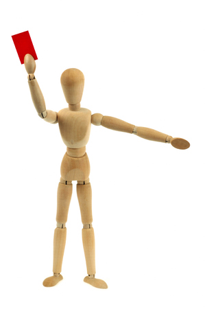 Wooden mannequin giving a red card