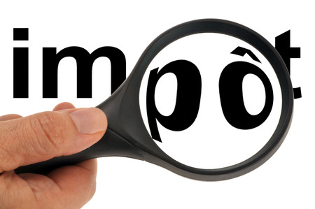 Tax with magnifying glass