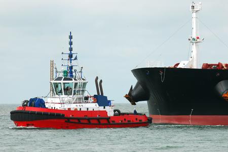 Tugboat pulling a tanker
