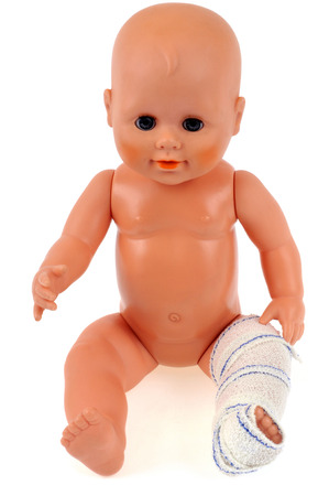 Doll with a foot bandage