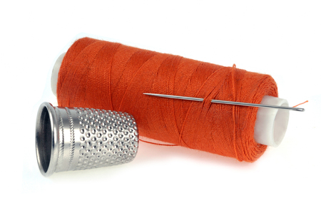 Thimble and spool of thread