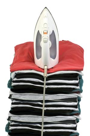 Iron on a pile of clothes Banco de Imagens