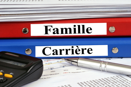 Family folder and career file stacked on a desk 版權商用圖片