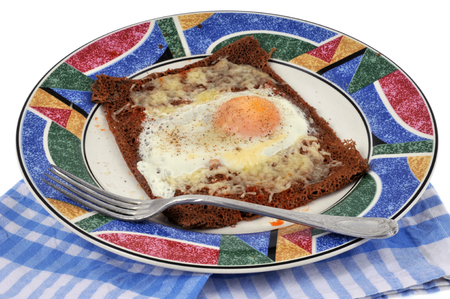Black wheat cake with an egg and grated cheese