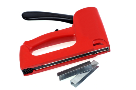 Wall stapler and staples on a white background Banco de Imagens