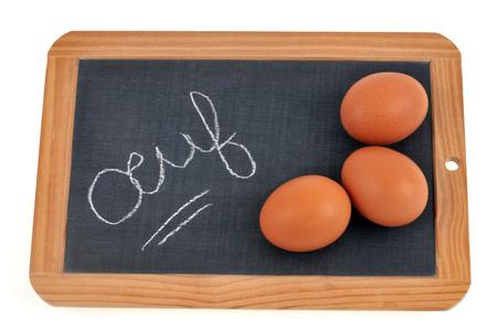 Eggs on a school slate Stock Photo
