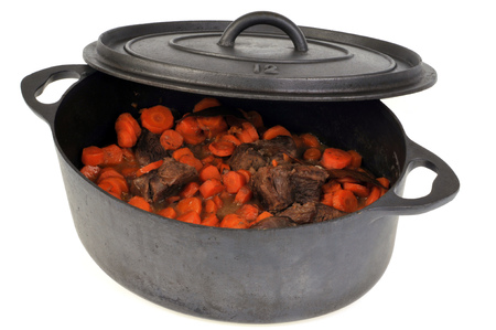 Beef carrots in a casserole make on white background Imagens