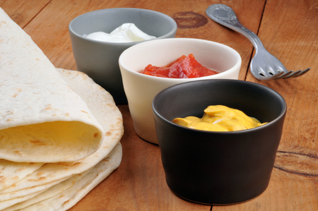 Corn cakes and sauce ramekin