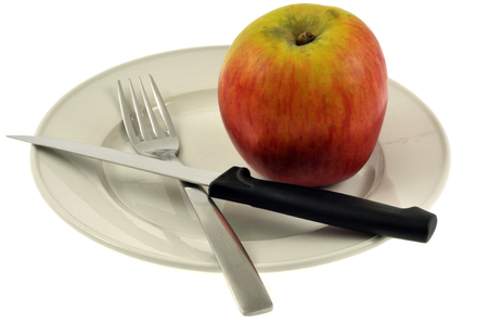 Diet concept with an apple on the plate