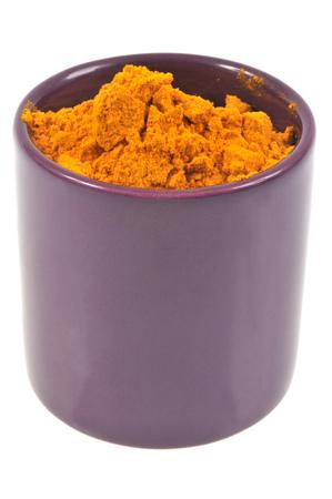 Ramekin of turmeric Stock Photo
