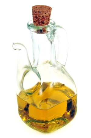 Carafe of olive oil on a white background Stok Fotoğraf