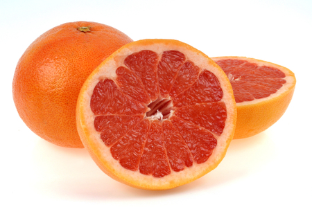 Pink grapefruit on a white background