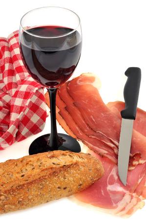Glass of wine, raw ham and baguette Banco de Imagens