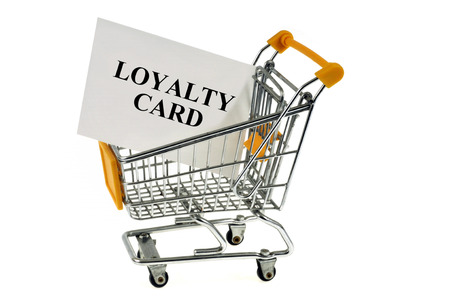 loyalty card in a supermarket cart on a white background