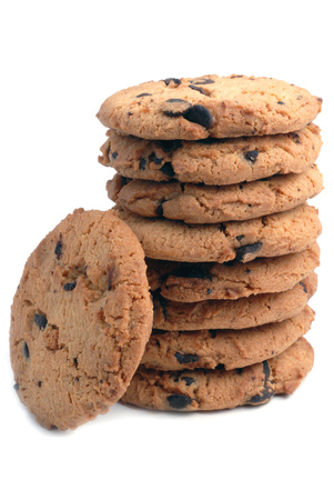Cookies with chocolate chips piled on white background