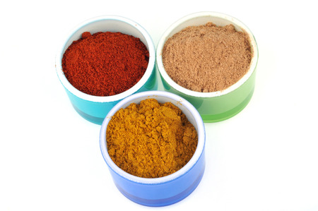 Ramekins of curry, paprika and ginger powder