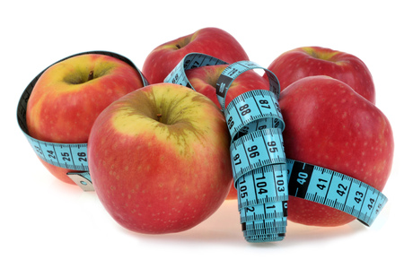 Apples and seamstress meter on white background