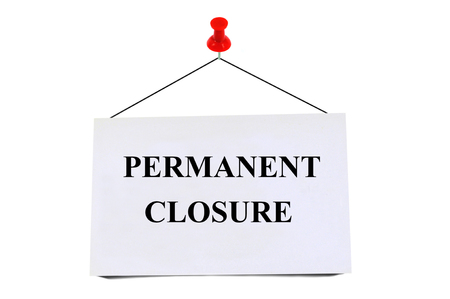 Permanent closure written on a map pinned on white background