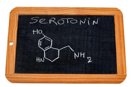 Serotonin chemical formula written on a slate
