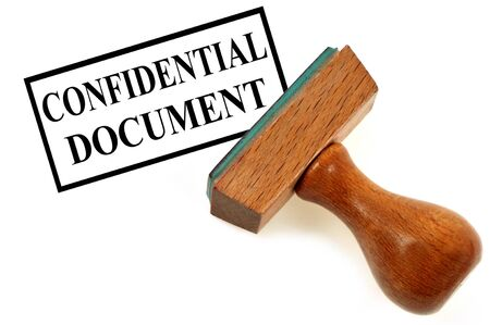 Inking stamp indicating confidential document 스톡 콘텐츠