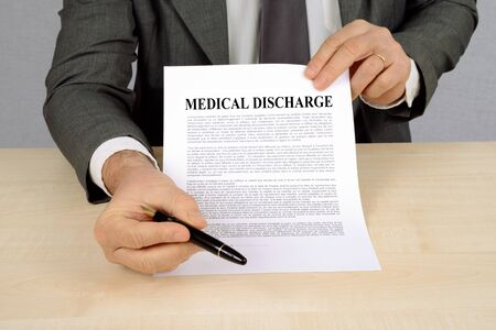 Unrecognizable man presenting a medical discharge