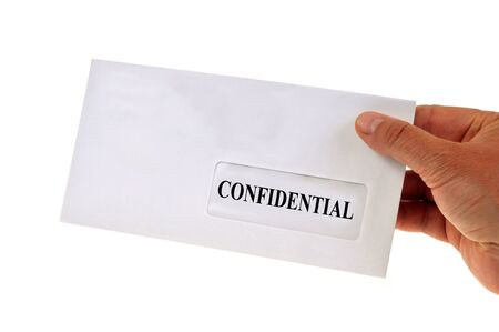 The confidential letter in hand on a white background