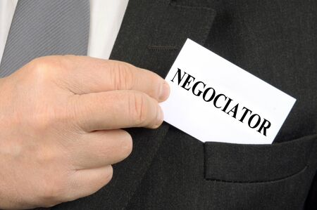 Negotiator business card in the pocket of a jacket