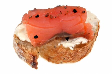 Slice of bread with raw salmon on a white background