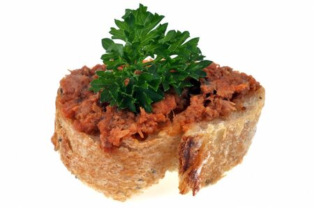 Bread slice with tuna crumbs and parsley on whiet background