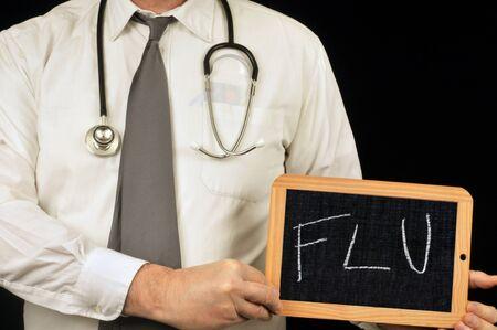 Unrecognizable doctor holding a school slate on which is written flu Banco de Imagens
