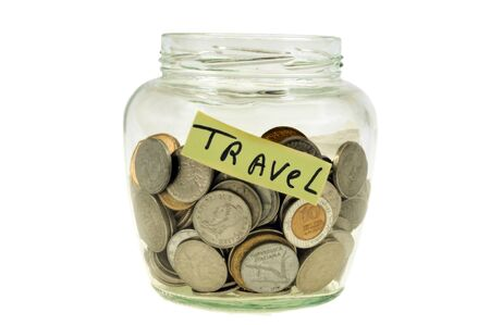 Savings for travel in a jar on a white background