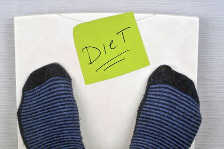 Diet concept with scales and diet written on a sheet