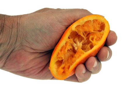 Orange pressed by hand on a white background