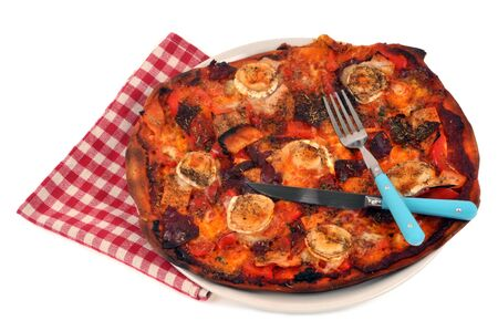 Homemade pizza in a plate with cutlery on a white background