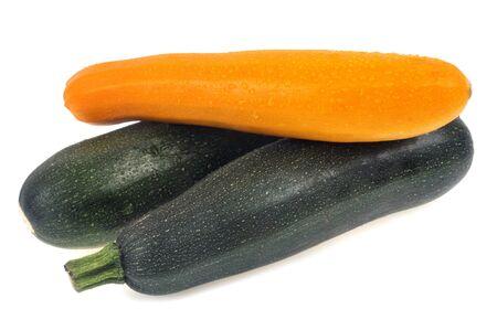 Green zucchini and yellow zucchini on white background Banco de Imagens