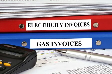 Electricity and gas invoices folders 写真素材