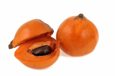 Medlar with a cut in half on a white background Banco de Imagens